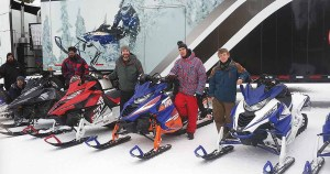 Owner Brent Gyuricza (center) and his two sons at a Yamaha demo. Maverick Motorsports has more sales volume from Yamaha than any other OEM.