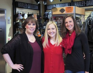 Stephanie Cook (left), manager of MotorClothes at Wild Prairie Harley-Davidson, with heart disease survivor Megan Hicks (center) and Alyssa Siech (right), director of Go Red For Women. Wild Prairie H-D donated 10 percent of the sales of selected items to Go Red For Women for the entire month of February.