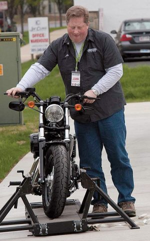 John Hardison, marketing manager for Battley Harley-Davidson, beside the Jumpstart simulator. The event gave 50 people the opportunity to test out how it felt to ride a real motorcycle.
