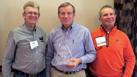 When the Texas Motorcycle Dealers Association gathered in Austin for its annual meeting, Alvin Sharp (center) had a story or two to tell. He founded Sharp's Motorcycle Sales in Pampa, Texas, in 1964, selling BSA and Bridgestone motorcycles. Sharp was awarded the Woody Leone Memorial Award for his contributions to the TMDA. Darryl Hurst (left) of Hurst Supply Co. in Columbus and Rick Higgins (right), a TMDA board member and a now a partner of Sharp's at Sharp's Motorsports in Amarillo, presented the award.