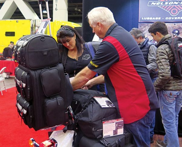 Rick Brooks, brand manager for Nelson-Rigg, shows a V-Twin Expo attendee one of the company's All Weather Dry Bags. The company's V-twin products are distributed by Drag Specialties and HardDrive.