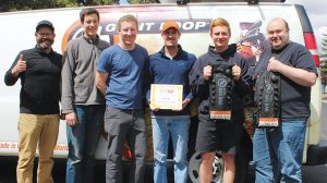 The Giant Loop team was proud to show offits 2016 Powersports Business Nifty 50 Award for its Fandango Tank Bag Pro. (From left) Harold Olaf Cecil, Giant Loop owner/founder; George Craig, operations manager; Dan Price, warehouse;  Brian Frankle, design director; Dakota Buer, warehouse; and Paul Robson, production manager.