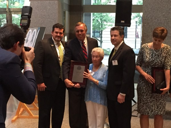 Mark Hendrix, Jean Price and Kris Weiss receive Ray Price's induction plaque at the N.C. Sports Hall of Fame ceremony.