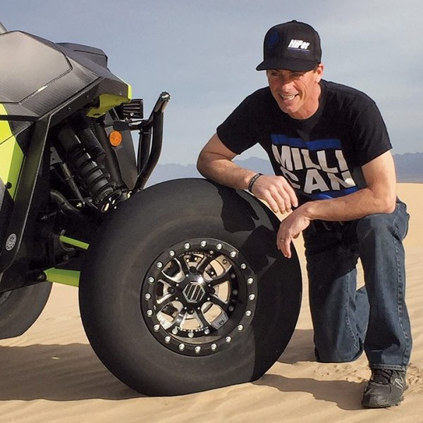 Clay Millican, father of the late Dalton Millican, poses with WELD's DM58 wheel, named in honor of his son.