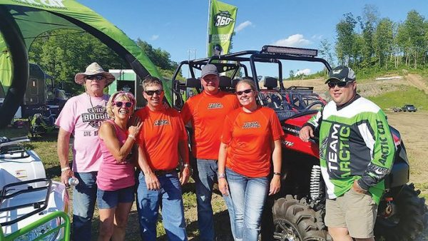 Arctic Cat Dealer Thomas Sno Sports, out of Ogilvie, Minn., was all smiles after the Friday poker run at High Lifter's Quadna Mud Nationals.