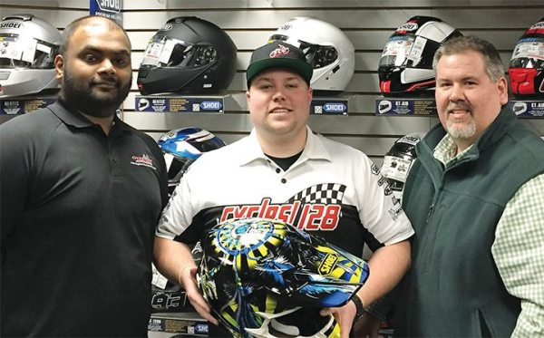 John Baker picked a SHOEI VFX-W Grant 2 off-road helmet, as the latest Helmet House prize winner. Cycle 128's parts manager Myooran Nakeswaran (left) and Helmet House account representative Mark Przechocki (right) joined him at the presentation.