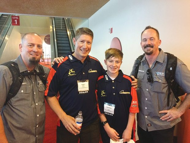 (From left) Drag Specialties rep Mike Merritt, Robert Smith, owner of Hill Country Custom Cycles in Spicewood, Texas with son Tyler, and Drag rep Chad Zimmerman during a break in the action at the NVP in Wisconsin.