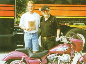 This 1992 photo shows Brian Klock and Willie G. Davidson with Brian's first custom bike.