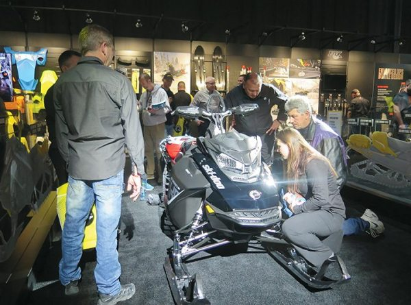 Dealers check out the 2018 Ski-Doo Summit SP 850 E-TEC at Club BRP in Reno, Nevada, in February.
