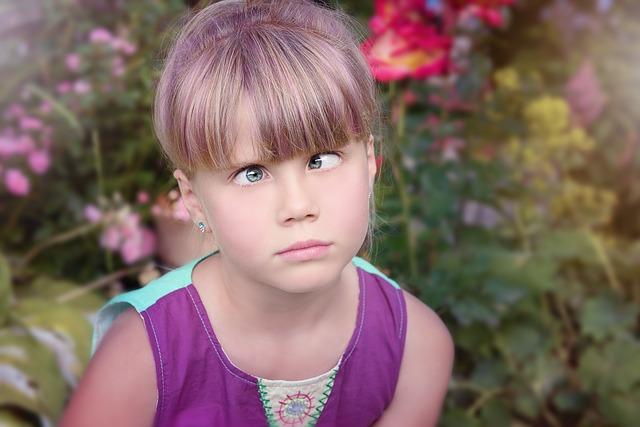 Young girl crossing eyes