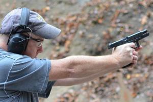 Brass jumps from Officer Mulkerin's handgun as he qualifies.