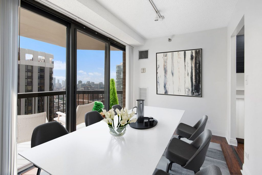 1133 N Dearborn Dining Room with Balcony Interior Chicago Apartments Gold Coast - 1