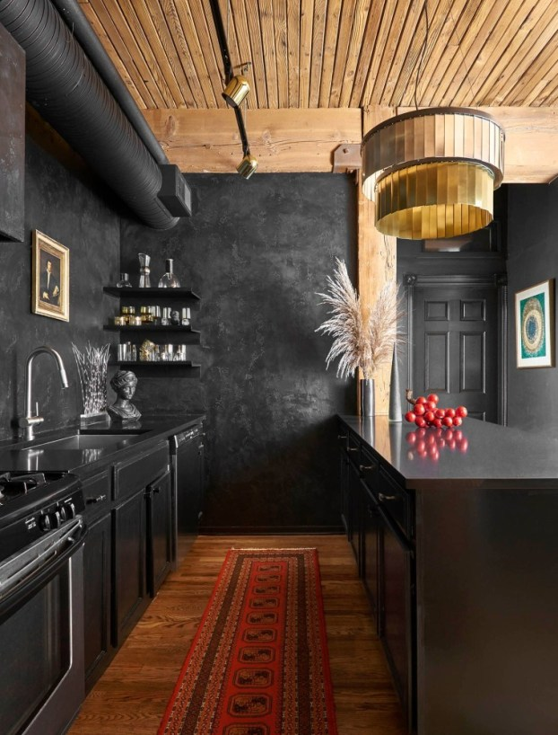 A Black and Red Kitchen With Vintage Accents