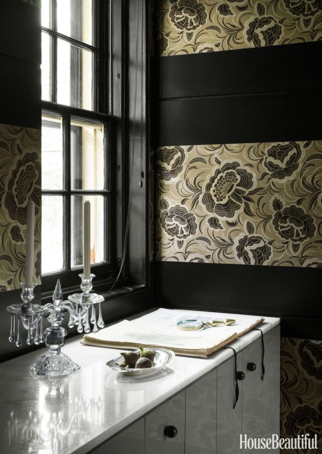 A Former Butler's Pantry With Dark Walls and Neutral Floral Wallpaper