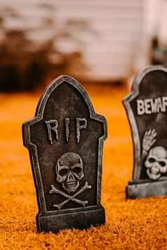 halloween headstones on grassy ground