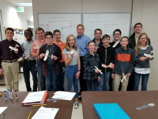John with 7th and 8th grade students at the Colorado Aerospace Laboratory.