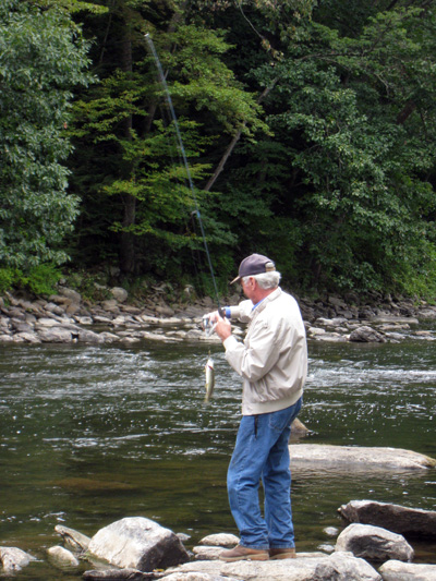 Bob catching a trout