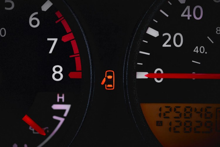 55132637 - car dashboard showing door ajar warning light