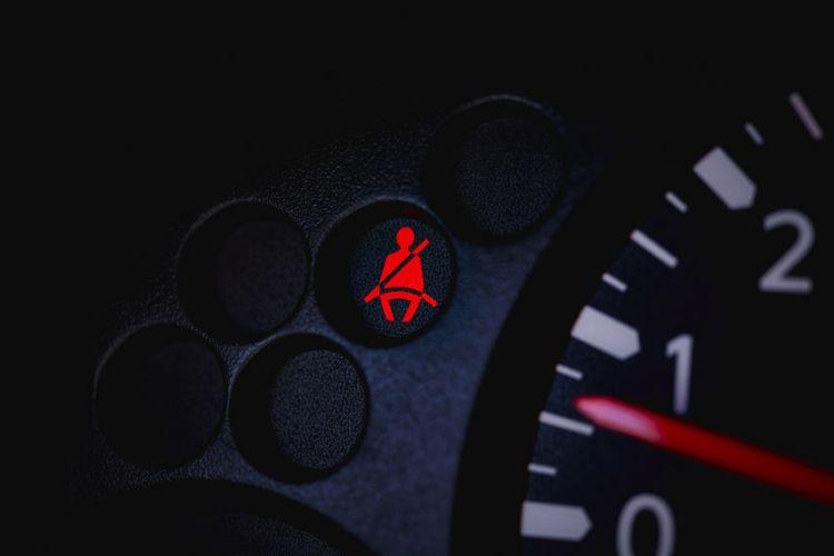 55133311 - car dashboard showing the seat belt warning light