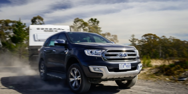 Ford Everest towing a caravan around a corner