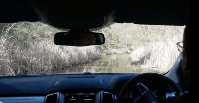 Ford Everest 4WD driving through a river
