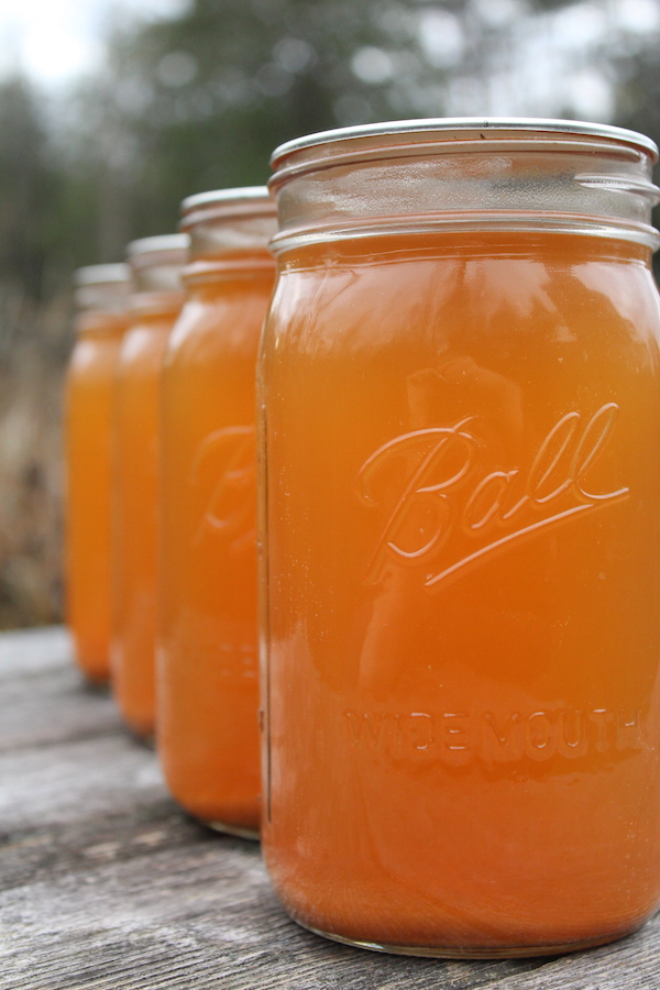 Four jars of home canned apple cider