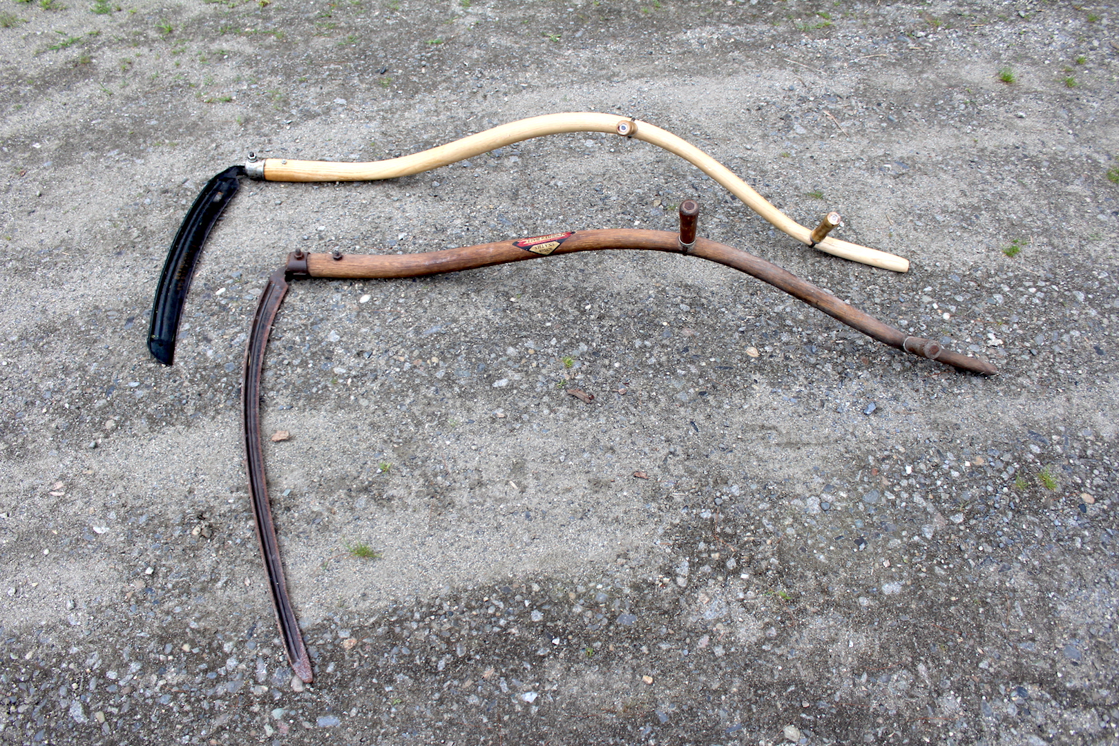 Two American style curved snaths (scythe handles).