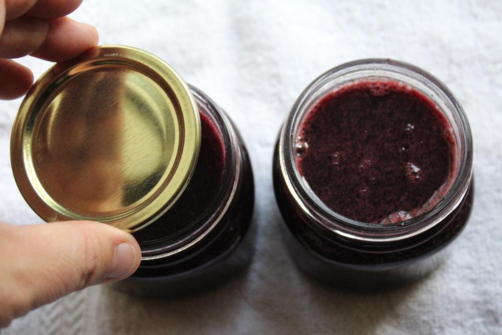 Filling Elderberry Jelly Jars