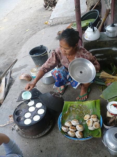 A woman making Serabi in Indonesia.