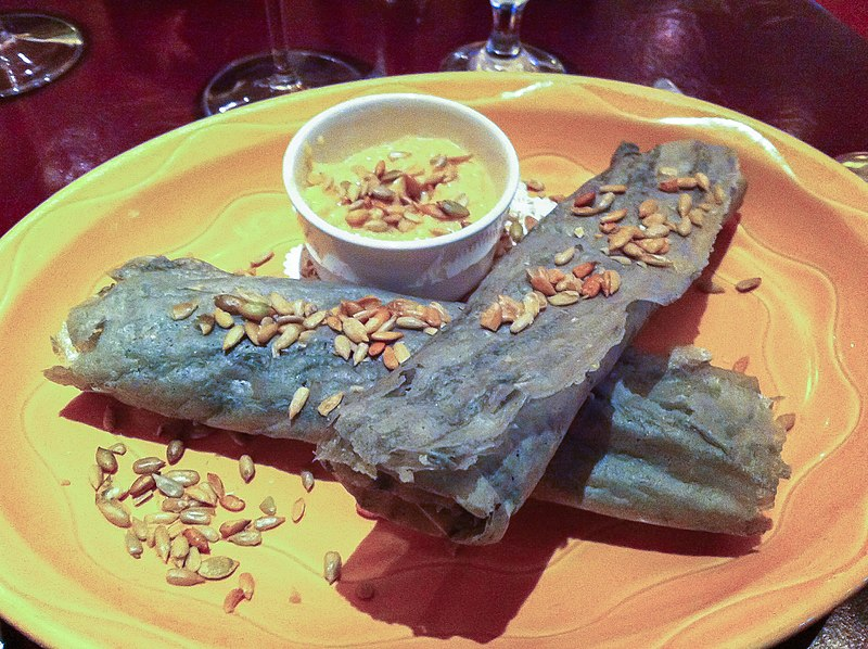 Piki, traditional Hopi Blue Corn cakes, rolled up and served at a modern restaurant in Arizona.