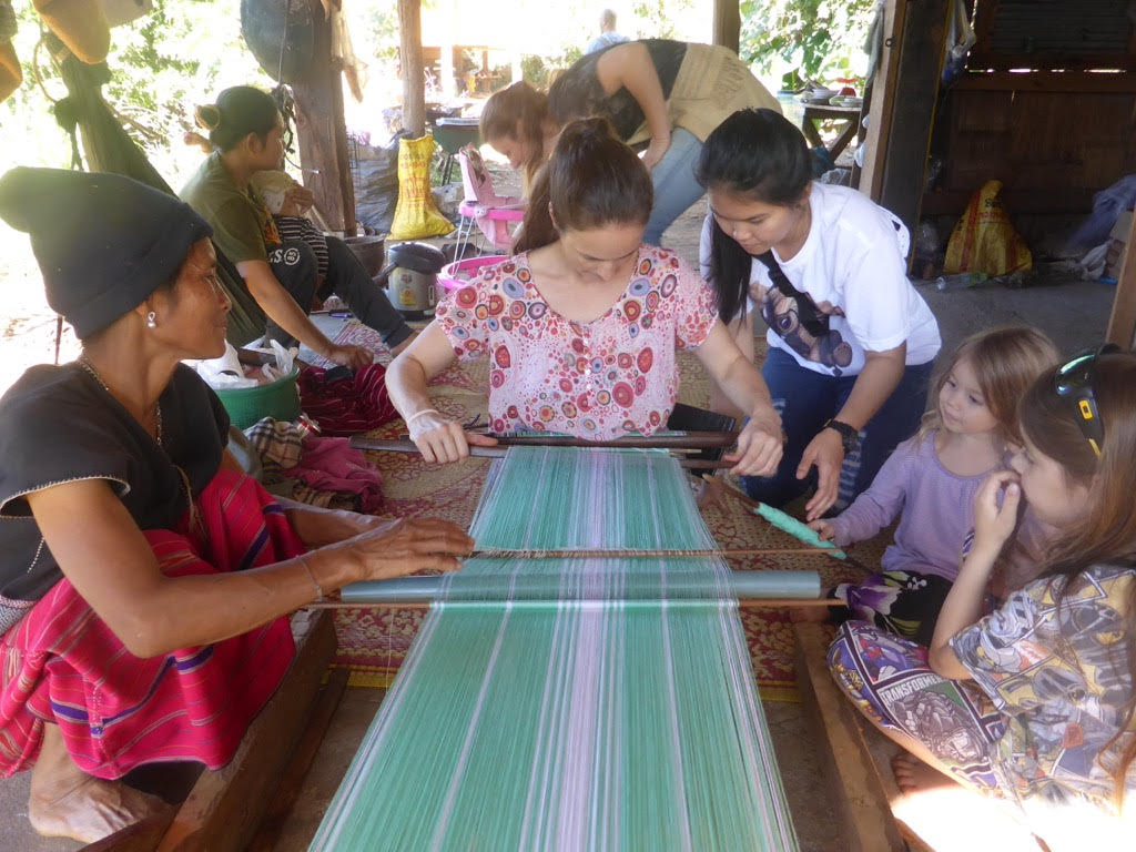 Learning traditional weaving during our homestay in Huay Pakoot, Northern Thailand