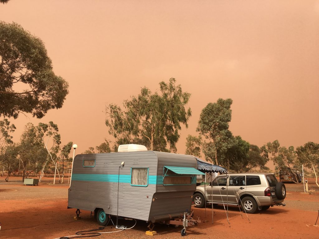camper in dust storm for worldschooling family in Australia