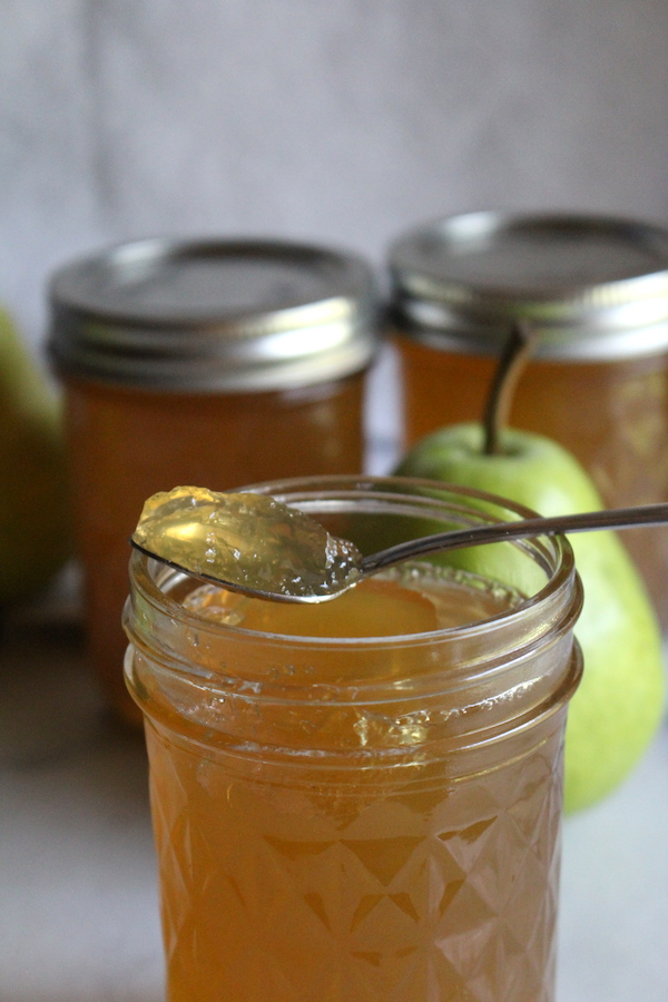 homemade pear jelly on a spoon