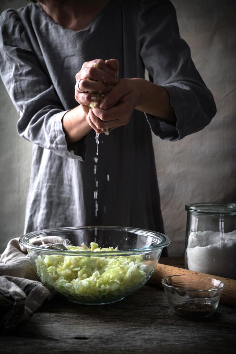Manually Pounding Sauerkraut