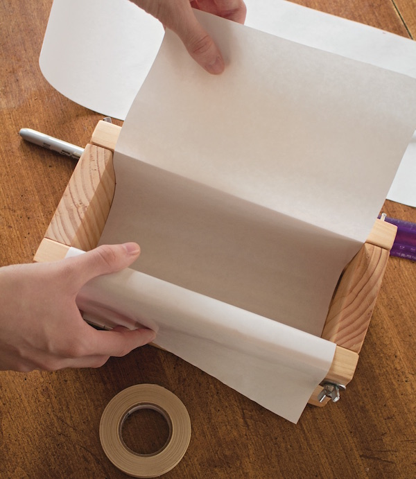 Lining a wooden soap mold with parchment paper