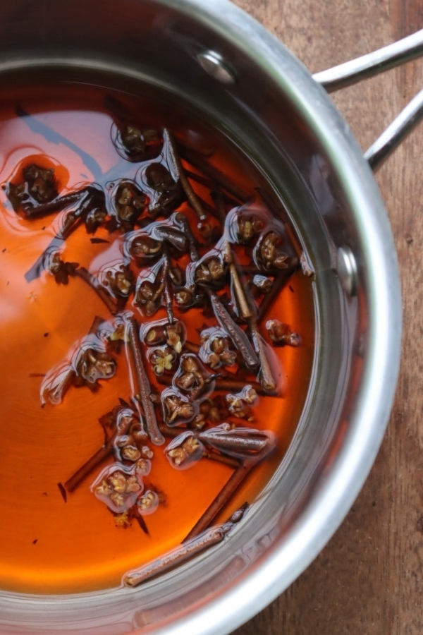 Simmering witch hazel twigs to make a decoction (fresh water extract)