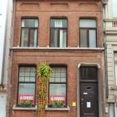 The brick facade of eco-friendly Kabas Hostel in Antwerp, Belgium.