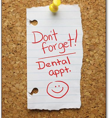 "portrait dental reminder postcard design with torn paper on cork-board, text reads ""Don't forget! Dental appointment"" in red, hand-written text."