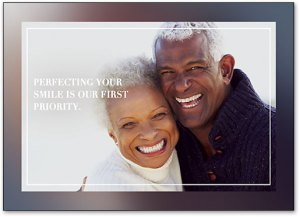 """dental reminder postcard with elderly couple, caption reads """"perfecting your smile is our first priority,"""""""