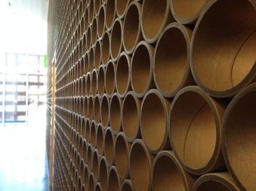 Cardboard tubes as wall divider.