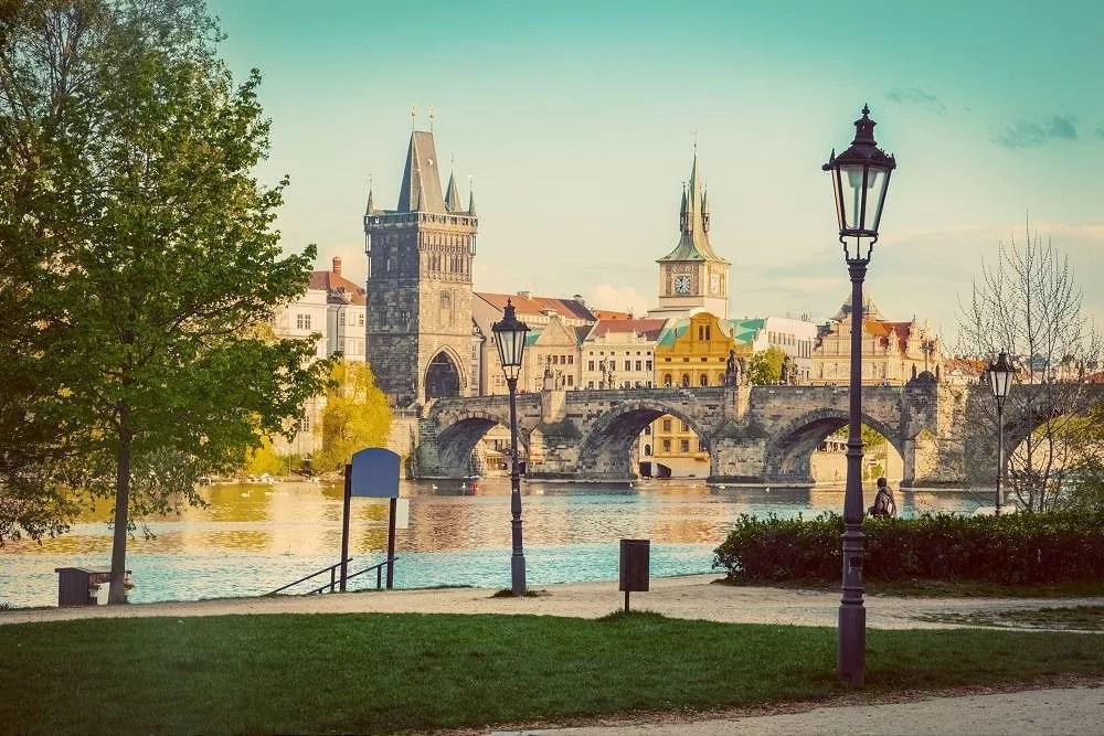 Prague, Czech Republic skyline with historic Charles Bridge and Vltava river as seen from spring park. Vintage