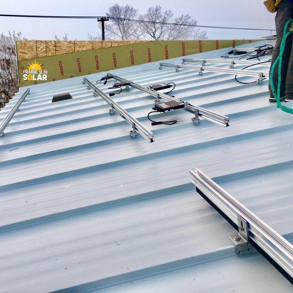 Metal roof with solar panels installed in sask