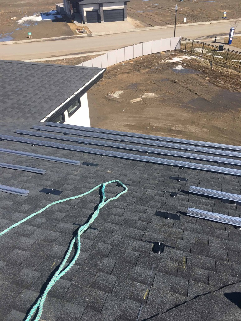 solar panels on a roof-first step install the anchors