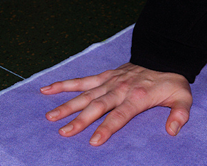 Photo: hand on a yoga mat