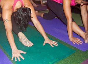Photo: yoginis in a hamstring stretch