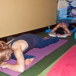 Photo: yoginis lie face down on mats