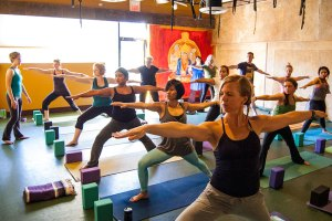 Photo: yoga class in Warrior 2 pose