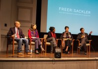 Photo: discussion panel on stage