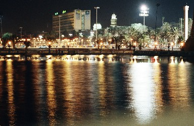 Reflections in the lake in front of Tripoli castle. Grand Hotel and Mosque of Shara Maghrief in long view...A long shot at life..Tripoli's evening charms