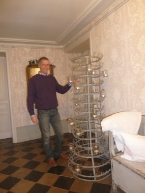 Duncan's find- an old iron work bottle dryer converted to a giant candelabra